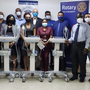 GBTI team up with Rotary Club of Georgetown to donate ECG machines to GPHC
